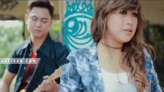 Lirik Lagu Peneduh Hati Tri Puspa feat Tut Nick Motifora