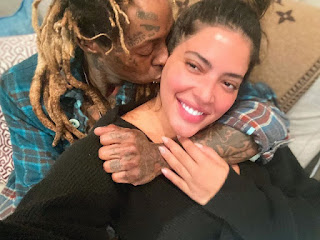 Lil Wayne shares pictures of him and his girlfriend in bed