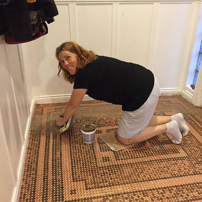 The woman decorated her floor with 7,500 pennies