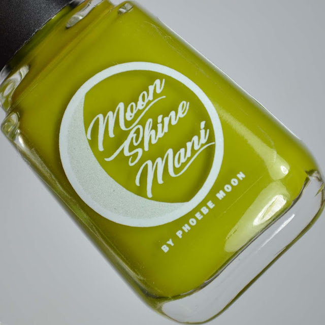olive creme nail polish in a bottle
