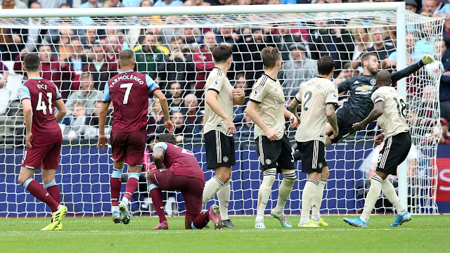 West Ham United 2-0 Manchester United The Man Utd players watch as Aaron Cresswell's sublime free-kick nestles in the net beyond David De Gea