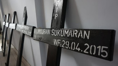 Crosses for the condemned, in the foreground Myuran Sukumaran's painted with his date of death.