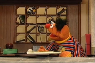 Ernie puts the the key for room number seven in the mailbox for room number seven. Sesame Street 123 Count with Me