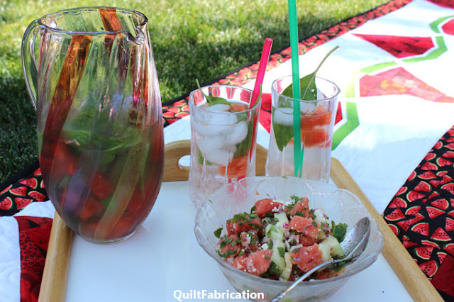 watermelon feta salad with watermelon-basil water in a pitcher and glasses