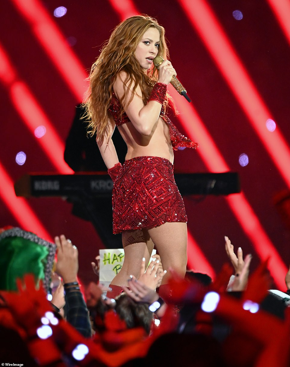 Shakira's red half-time show ensemble featured intricate beading and choreo-friendly fringe