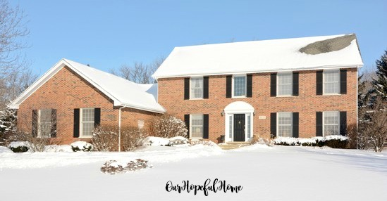 brick colonial house garage shutters snow Home Alone movie