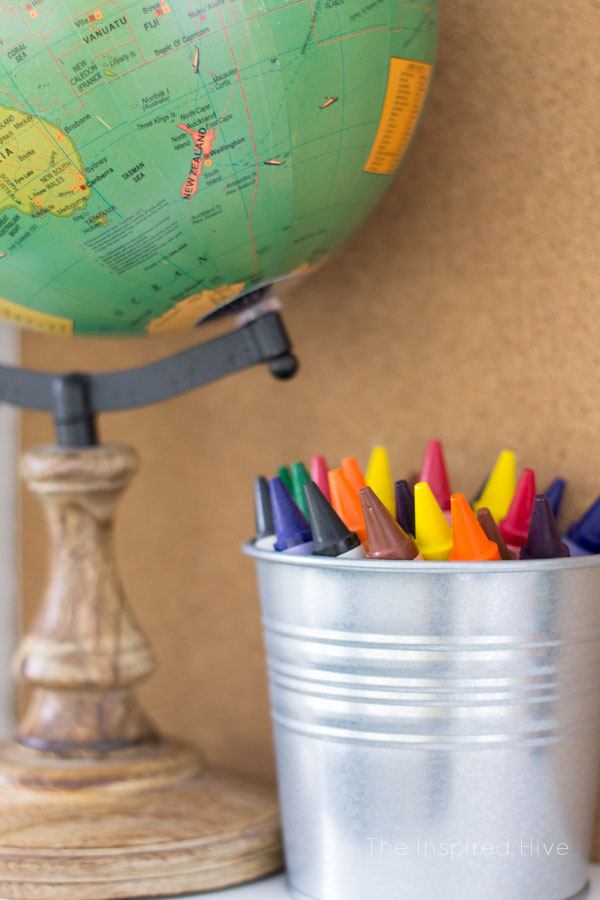 Cute way to store crayons in this vintage modern schoolhouse playroom.