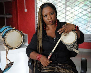 woman playing the talking drum