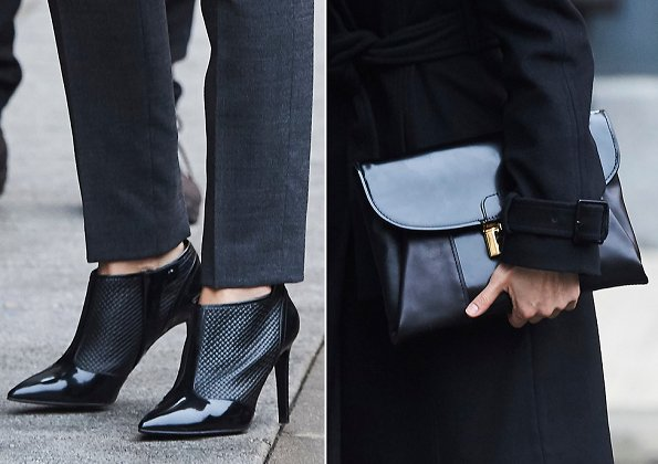 Queen Letizia wore ankle boots and carried clutch bag