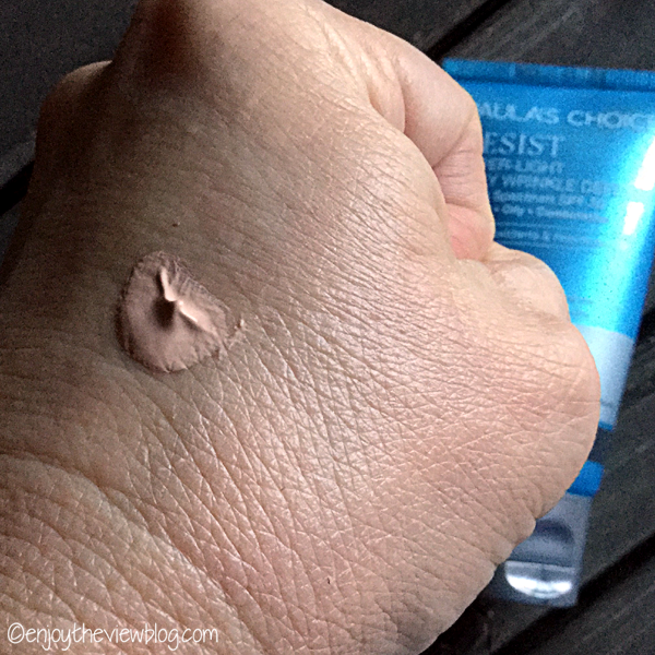 Paula's Choice RESIST Super-Light Daily Wrinkle Defense sample on the back of a hand
