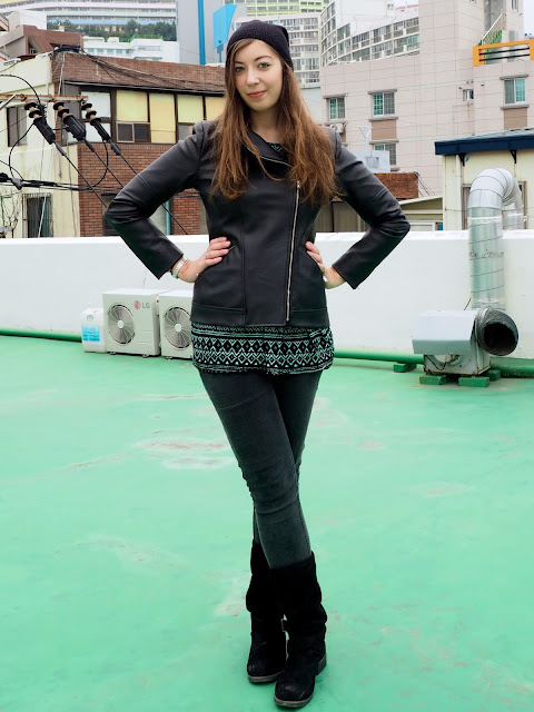Beanie & Boots | outfit of black leather jacket, green print top, grey jeans, tall black suede boots & beanie hat