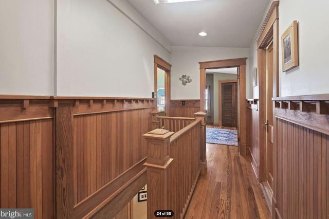 color photo of upstairs hallway looking into bedrooms Sears Kilbourne 4219 Nicholson Street, Hyattsville, Maryland