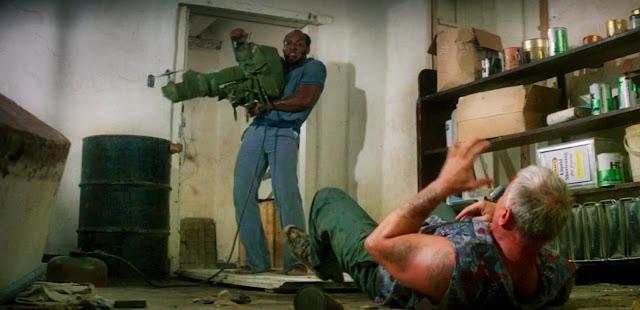 Earl Maynard as 'Ronald' prepares to slash Robert Tessier as 'Kevin'