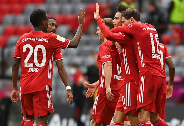 Bundesliga champions Bayern Munich players celebrate a goal