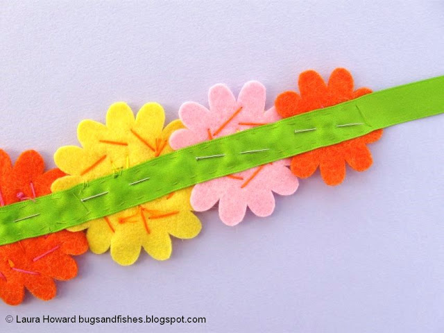 Felt Flower Crown Sewing Tutorial: pin then sew the flowers to a length of ribbon