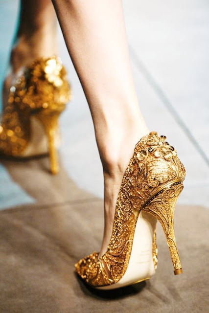 Gold pumps by Dolce and Gabbana