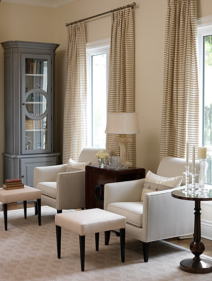 Stripe drapery panels and neutral decor in an elegant living room by Sarah Richardson