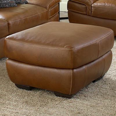 contemporary leather ottoman by Natuzzi