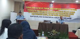Kadiv Pelayanan Hukum dan HAM Kanwil Kemenkumham Provinsi Jambi Buka Sosialisasi UU 42 Tahun 1999 Tentang Jaminan Fidusia.