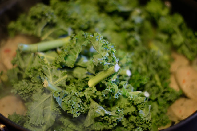 The chopped kale added to the pan.