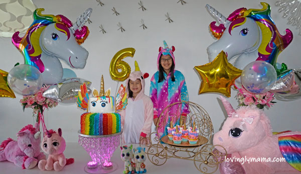 unicorn girl - unicorn onesies- unicorn cake - rainbow unicorn cake - unicorn cupcakes - 6th birthday pictorial - Bacolod Cupcake Cafe - unicorn foil balloons - Bacolod mommy blogger - birthday party - unicorn cake - unicorn cupcakes - birthday candles - unicorn costumes -unicorn onesies