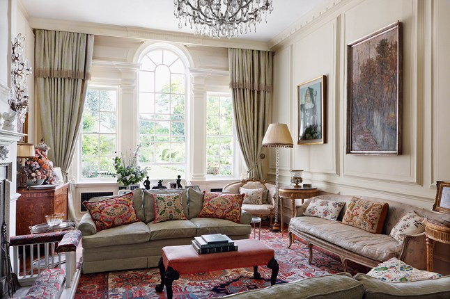 Traditional English living room in cream design by Caroline Harrowby