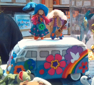 Craft fair impression: felt flower power volkswagen bus with hippies on top