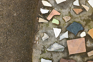 tile pieces in sidewalk in Puriscal