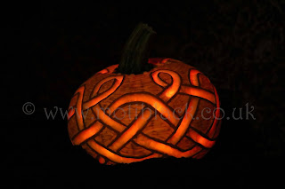 An all over pumpkin carving using a celtic knot design
