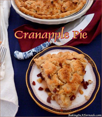 Cranapple Pie is an apple pie studded with little tart bursts of cranberry and the crunch of walnuts. | Recipe developed by www.BakingInATornado.com | #recipe #pie