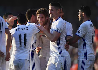 chelsea maintain seven points lead