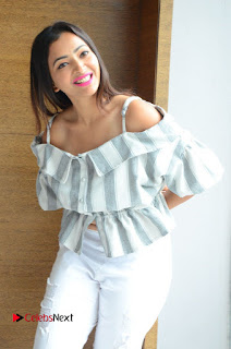 Actress Shweta Basu Prasad Latest Pictures in White Ripped Jeans .COM 0032.JPG