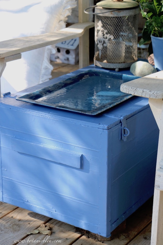 A blue melamine serving tray is a good to use outside on the rustic blue box