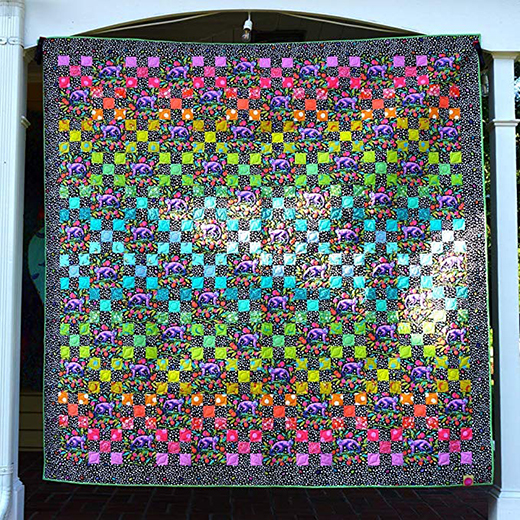 Daisy Chain Dark Quilt Designed by Tula Pink for Free Spirit Fabric, featuring Monkey Wrench Collection