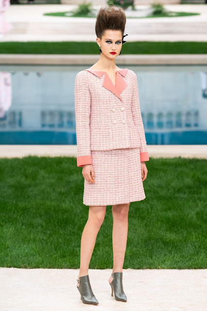 The new power suit in pastel tweed from Karl Lagerfeld for Chanel.