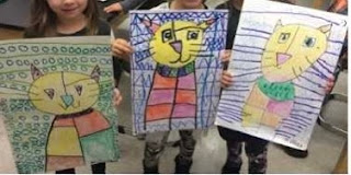 child drawings of patterned cats and background