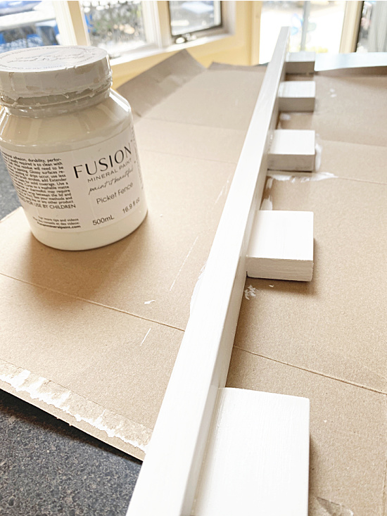 painting the shelf with fusion mineral paint