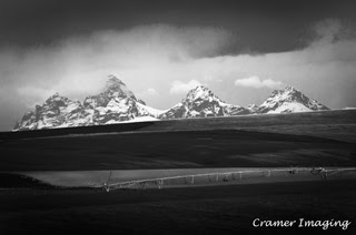 Cramer Imaging's professional quality nature landscape photograph of the Teton mountain peaks and a farm field near Driggs, Idaho