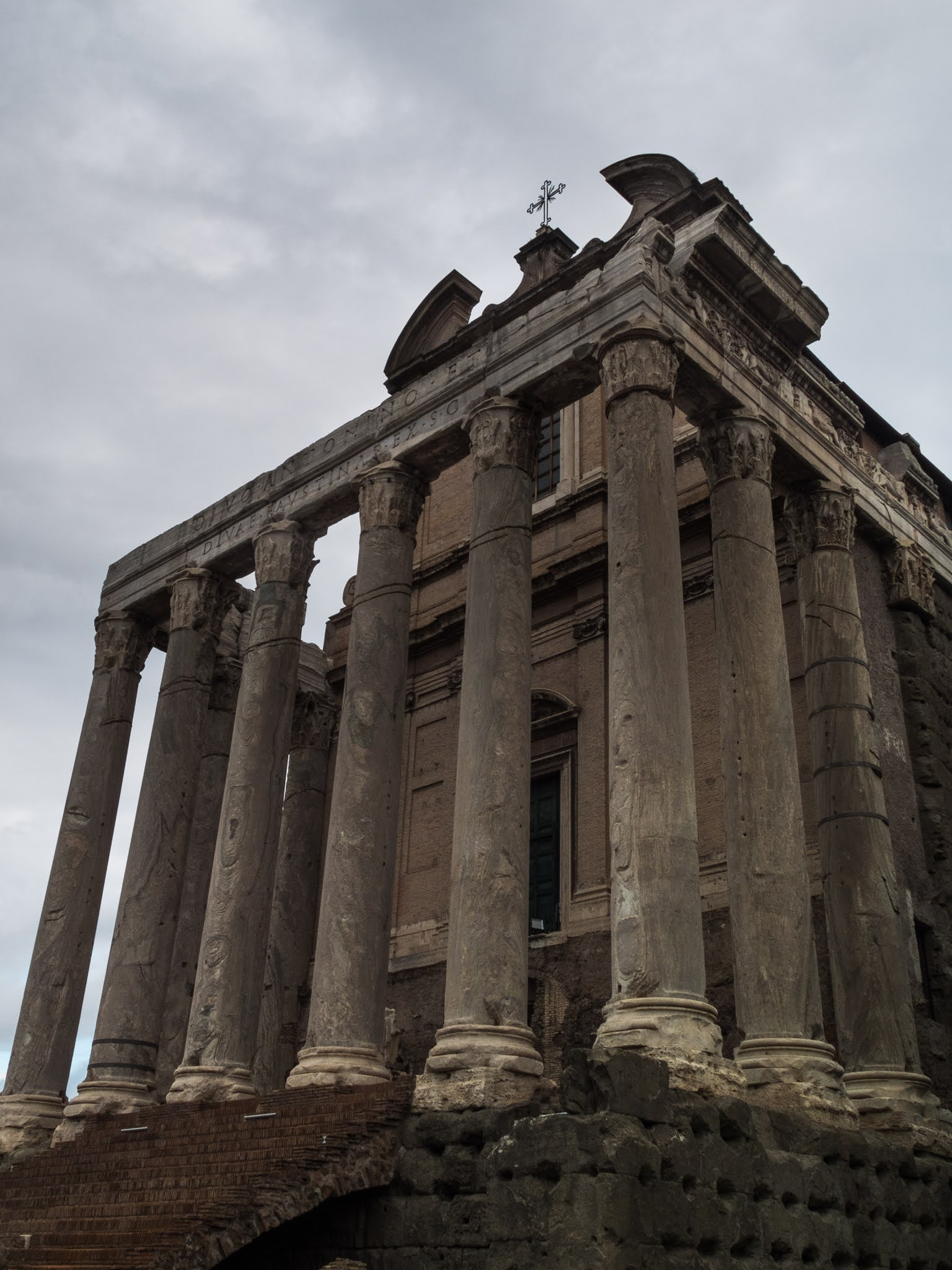 Looking up at the columns and the Temple of Antoninus and Faustina