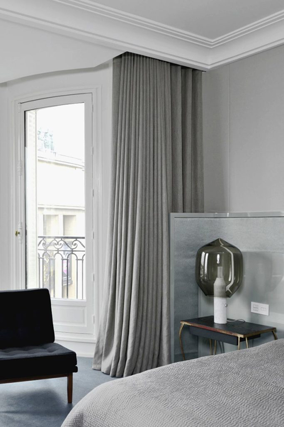Grey contemporary chic bedroom by Tristan Auer