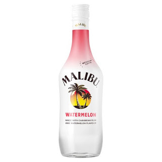 A photo of a white cylrindrical bottle filled with clear liquid with ,Malibu in black font with watermelon in red and green font on a bright background