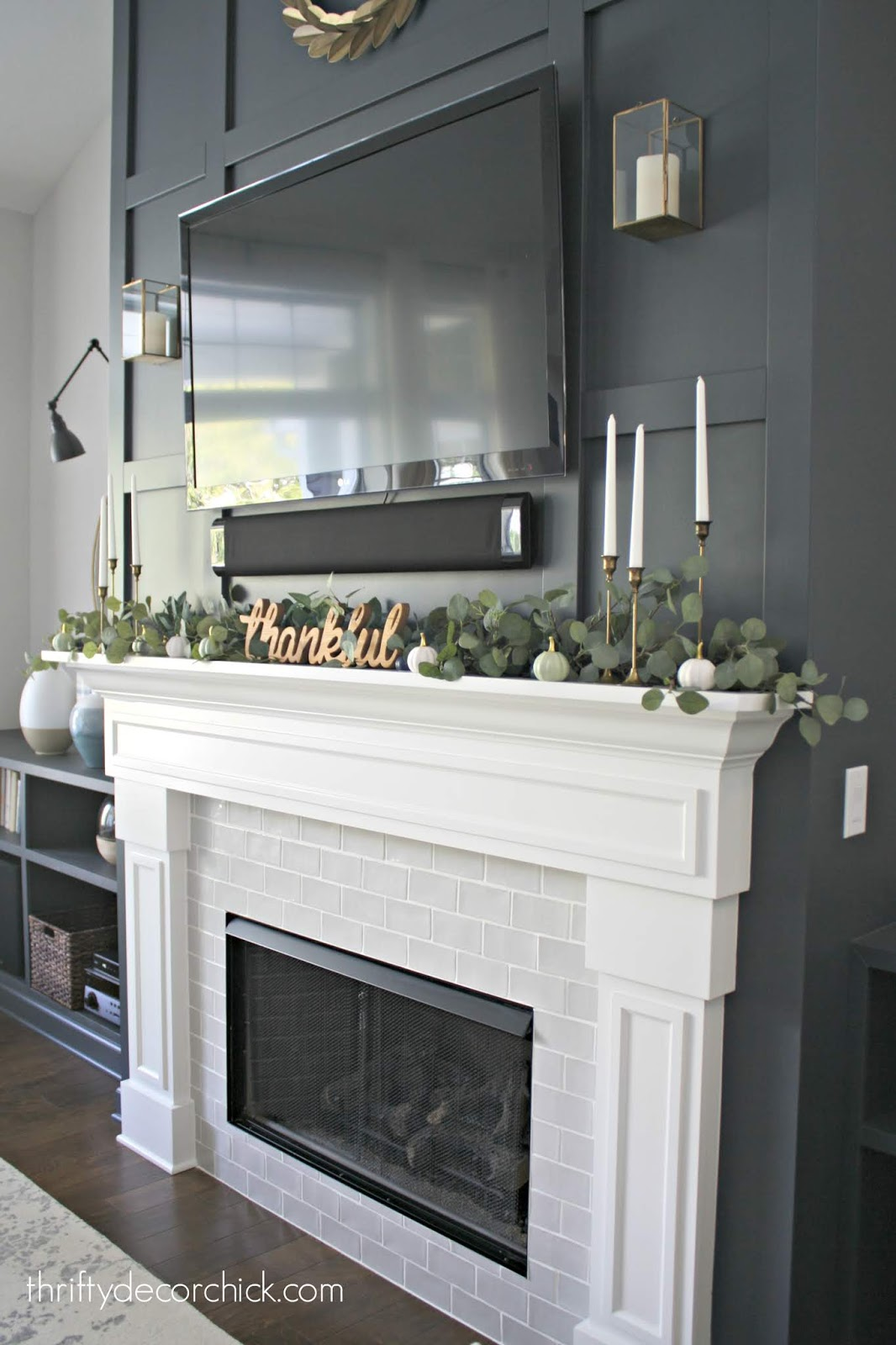 Simple fall mantel with greenery and candles