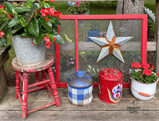 Photo of a deck junk garden vignette.