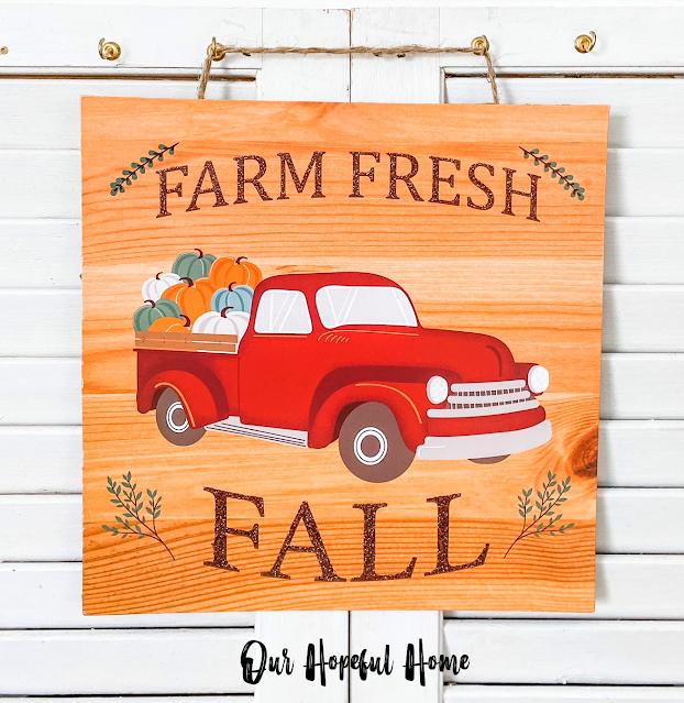 Farm Fresh Fall Dollar Tree sign pickup truck with pumpkins in back