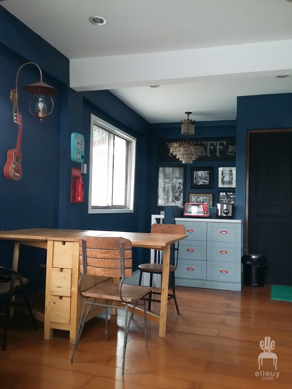 navy blue walls, norden table, gallery wall, small dining space, loft table