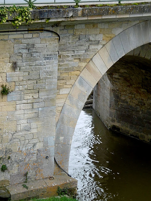 Flood markers on the bridge over the Creuse River at Descartes.  Indre et Loire, France. Photographed by Susan Walter. Tour the Loire Valley with a classic car and a private guide.