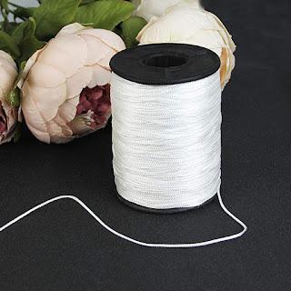 hilo de nylon para atar botones de tapicería