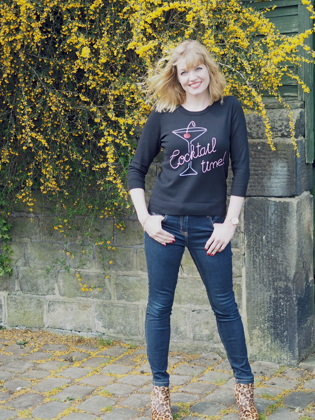 What Lizzy Loves. Cocktail glass logo top worn with skinny jeans and high-heeled leopard print boots