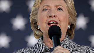 Clinton: I Don't Recall Joking About Droning Julian Assange