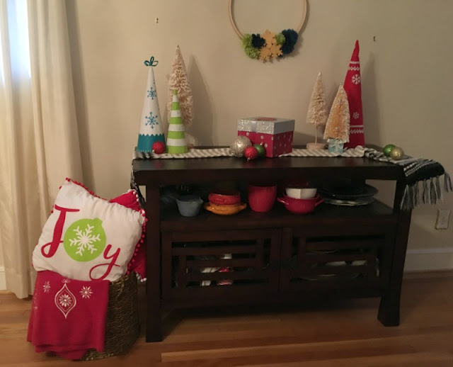 I am excited to show you some affordable ways to decorate a buffet for Christmas. I went with a bright color scheme, using reds, greens, and teals.